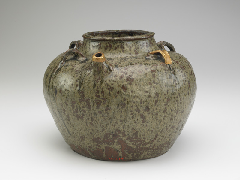 Jar with five vertical lugs and short spout