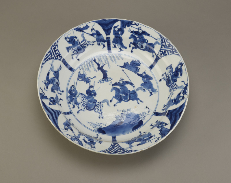 Plate with design of battling warriors, one of a pair with F1992.15.2